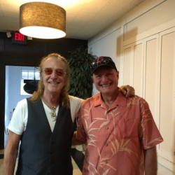 Foghat founding member Roger Earl (left) with Mark Stewart at location sponsor Big Room Bar/CD102.5.